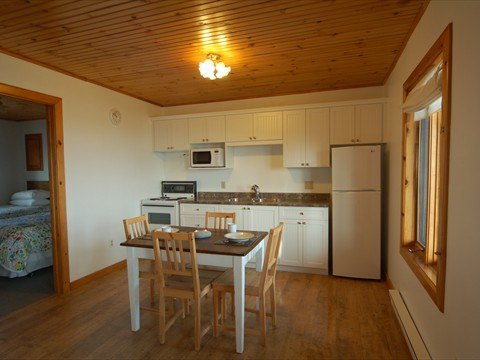 Kitchen and dining areas in Seaside Cottages