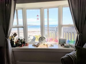 Ginger Hill Cottage bow window gives you a front row ocean view.