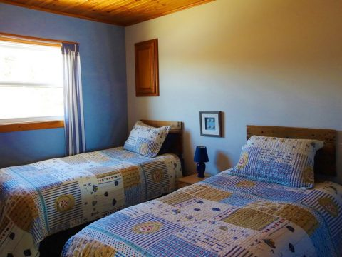 Each cottages has one bedroom with twin beds.