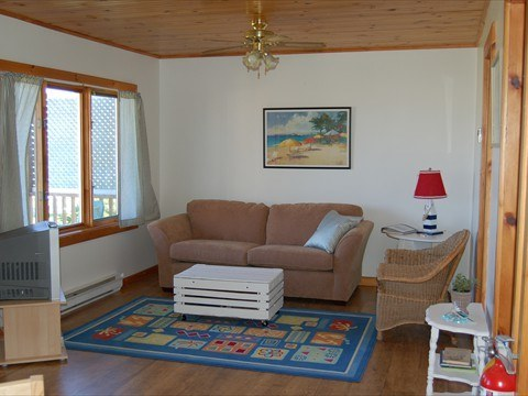 Watch the surf on the beach from the large living room windows